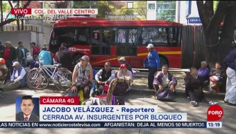 Manifestantes bloquean avenida Insurgentes, al cruce con eje 5