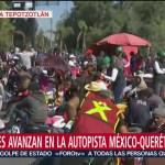 Migrantes avanzan en la Autopista México-Querétaro