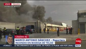 Bomberos de varios municipios del EdoMéx combaten fuego en fábrica de telas