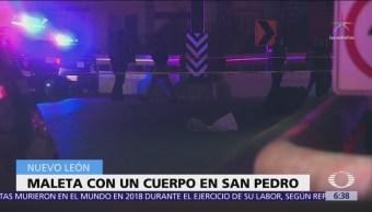Encuentran cadáver en maleta sobre puente de San Pedro, NL