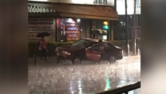 Lluvia sorprende a población Valle de México