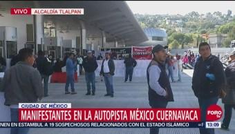 Manifestantes permiten paso libre en caseta de la autopista México-Cuernavaca