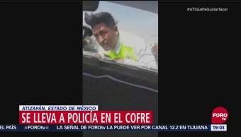Conductor Se Lleva A Policía En Cofre