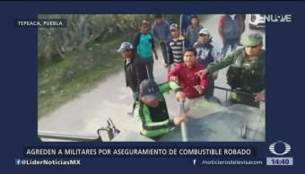 Pobladores en Puebla agreden a vehículo del Ejército