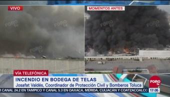 Reportan bajo control incendio en bodega de telas en Toluca
