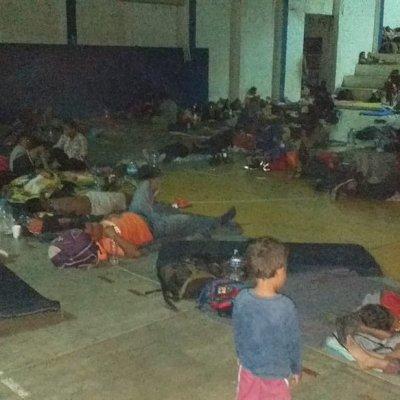 Migrantes centroamericanos descansan en Mapastepec, Chiapas