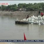 Migrantes cruzan río en Ciudad Hidalgo, Chiapas