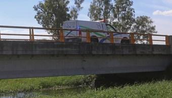 Fiscalía de Jalisco identifica dos de los 20 cuerpos localizados en un canal de la ZMG