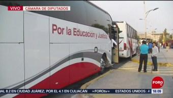 Foto: Integrantes de la CNTE abordan autobuses para volver a Oaxaca
