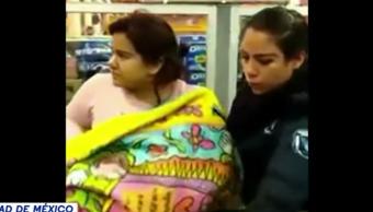 mujer-finge-cargar-bebe-robar-supermercado-articulos-higiene-centro-comercial