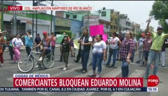 Foto: Comerciantes bloquean Eduardo Molina