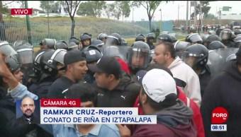 Comerciantes y policías se enfrentan durante bloqueo en CDMX