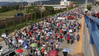 Foto: Vista general de una protesta en Tegucigalpa, Honduras, promovido por médicos y maestros, junio 1 de 2019 (EFE)