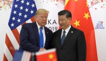 Foto: El presidente Donald Trump (i) posa para una foto con el presidente chino Xi Jinping (d) durante la cumbre del G-20 en Osaka, Japón.