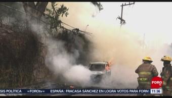 Cable de alta tensión provoca incendio en autos en San Pedro, NL