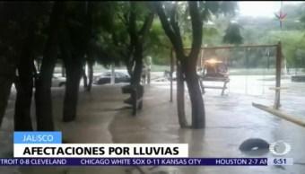 Se desborda canal por lluvias en Zapopan, Jalisco