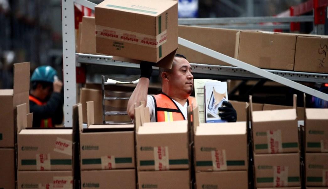 Foto: Trabajador mexicano de empresa de paquetería, 9 de abril de 2019, Ciudad de México