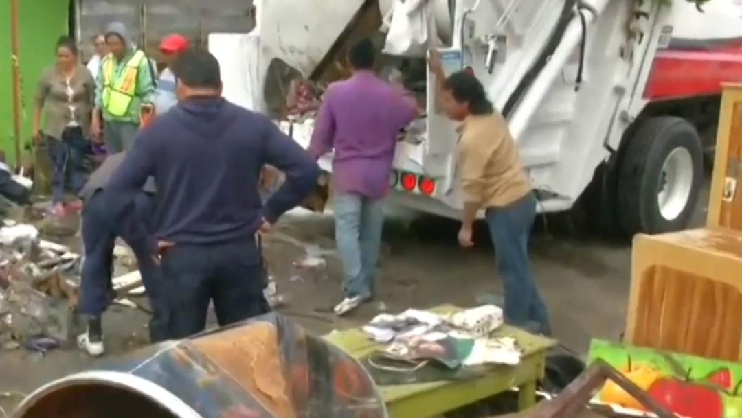 Foto: Limpieza tras inundaciones en Villa Nicolás Romero, 7 de agosto de 2019, Estado de México