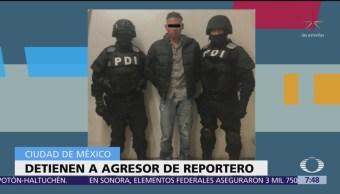 Detienen a hombre que golpeo a reportero durante marcha en CDMX