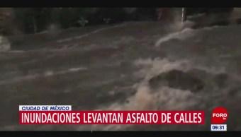 Fuertes lluvias levantan el asfalto en la alcaldía Álvaro Obregón