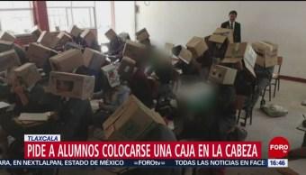FOTO: Maestro pone cajas cartón cabeza alumnos para que no copien