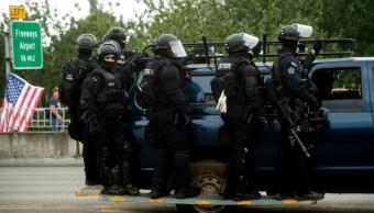 """Foto: La Policía ordenó el cierre de algunas vías en el centro de la ciudad, informó de la incautación de """"armas"""", 17 de agosto de 2019 (AP)"""