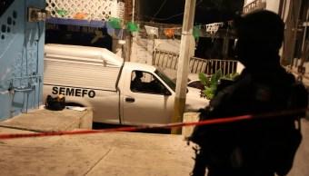 Foto: Un vehículo del Servicio Médico Forense (Semefo) recoge un cuerpo en el estado de Guerrero. Cuartoscuro
