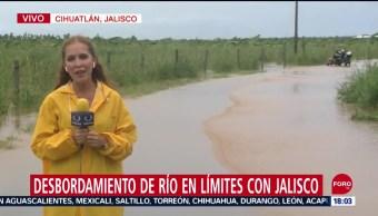 FOTO: Lorena desborda rio límites Colima Jalisco