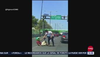 Microbuseros atropellan y golpean taxista en Tlalpan