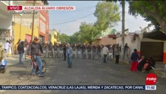 Arrojan bombas molotov durante desalojo de inmueble en la Álvaro Obregón