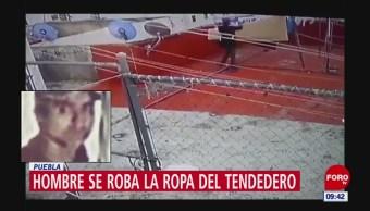 Hombre se roba la ropa de un tendedero en Puebla