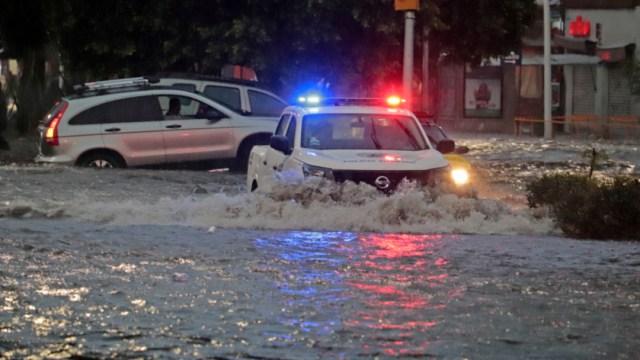 Imagen: A lugar acudió personal de Protección Civil, además de maquinaria pesada para poder liberar la carretera, 20 de octubre de 2019 (Cuartoscuro.com)