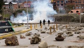 Foto: Manifestantes que apoyan al presidente Evo Morales se enfrentan con la Policía, el 11 de noviembre de 2019 (Getty Images)