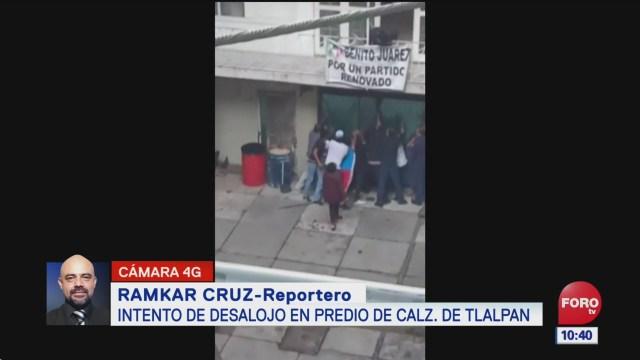 Conato de riña en desalojo en calzada de Tlalpan