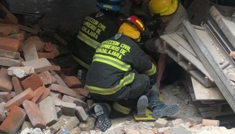 Derrumbe en edificio de Guadalajara deja un muerto