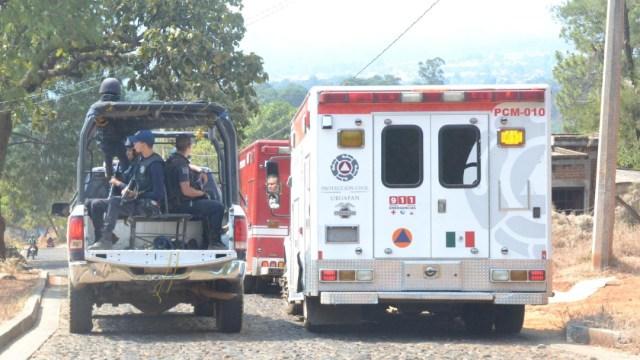 Foto: Autoridades acudieron al sitio donde localizaron abandonada una camioneta donde había 4 cuerpos sin vida, 9 de noviembre de 2019 (Noticieros Televisa)