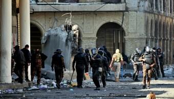 FOTO Manifestantes chocan policías en Bagdad, hay 3 muertos (AP)