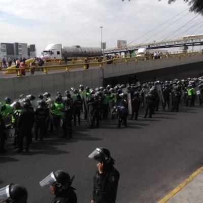 Videos y fotos: enfrentamiento de policías federales y capitalinos en AICM