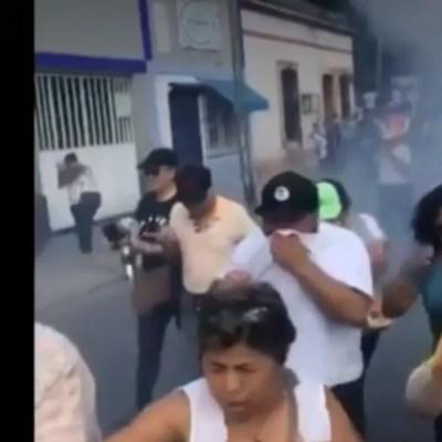 FOTO: Policías usan gas lacrimógeno contra manifestantes en Yucatán, el 19 de enero de 2020