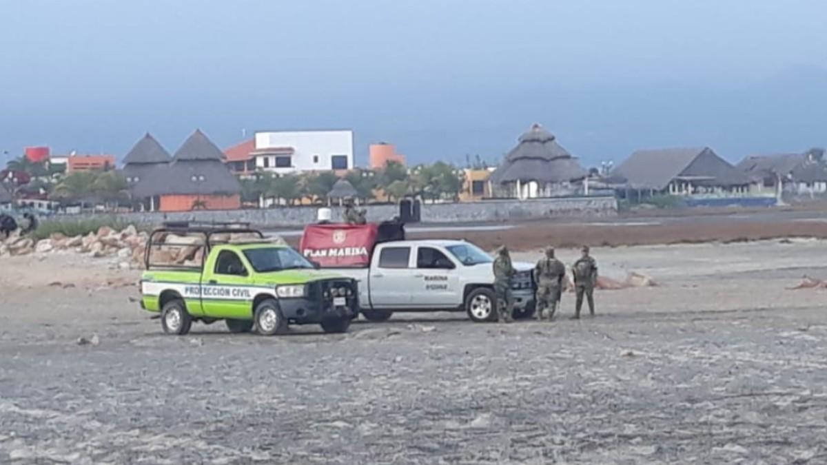 Foto: Elementos de la Marina y Protección Civil de Oaxaca hallaron el cuerpo de Marcela. Twitter/