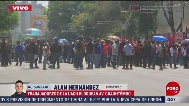 FOTO: trabajadores de uach bloquean av cuauhtemoc