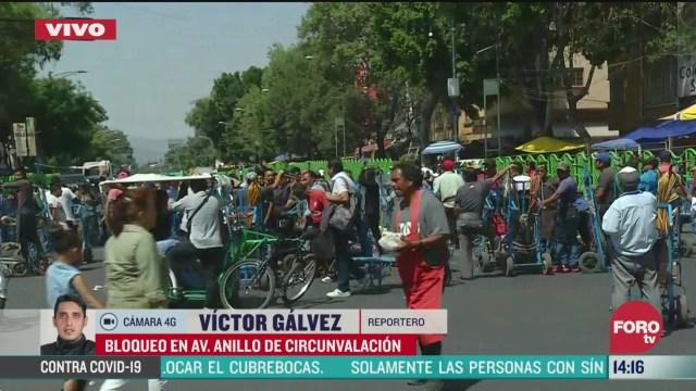 FOTO: comerciantes bloquean avenida anillo circunvalacion en cdmx