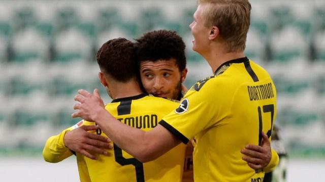 Jugadores del Borussia Dortmund celebran un gol al Wolfsburg. Getty Images