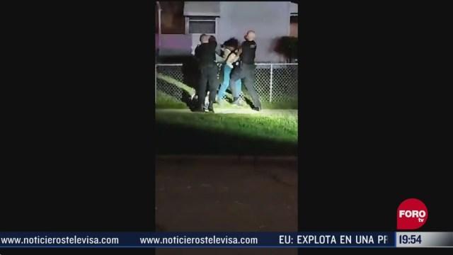 policia de michigan golpea a una mujer