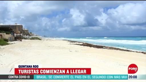 cancun recibe a sus primeros turistas tras confinamiento