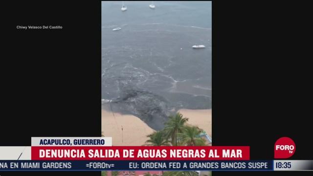captan momento en arrojan aguas residuales al mar de acapulco