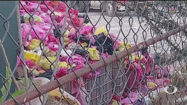 Usan bodega en Puebla como tiradero de basura COVID