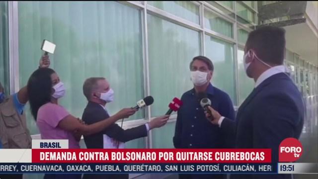Jair Bolsonaro presidente de Brasil demandado por quitarse el cubrebocas y tener COVID 19