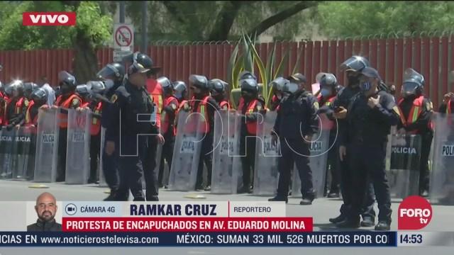 encapuchados protestan en avenida eduardo molina