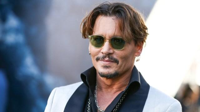 Johnny Depp niega haber abofeteado a su exesposa por reírse de su tatuaje